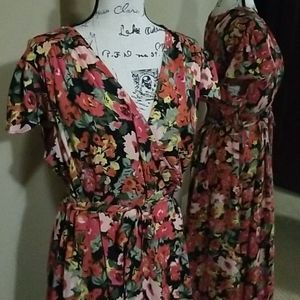 Black maxi dress with bright floral color designs,